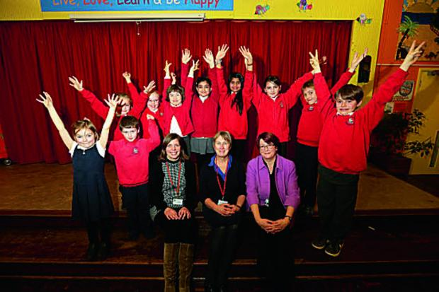 thisisoxfordshire: Head Rachel Crouch, centre, with special needs co-ordinator Vicky Davison, left, and deputy director of Oxfordshire County Council, Frances Craven, and school council pupils Picture OX65216: Damian Halliwell
