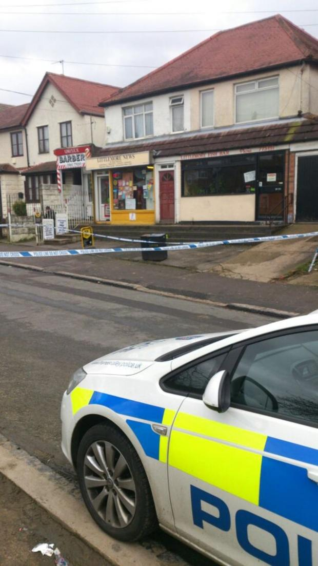 thisisoxfordshire: Police at the scene of a robbery of a Littlemore newsagents