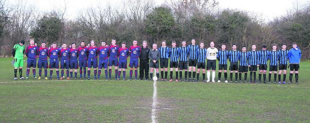 thisisoxfordshire: The Marston Saints and OUP teams stand for a minute's silence before kick-off on Saturday to remember Derek Measor              Picture: Steve Wheeler