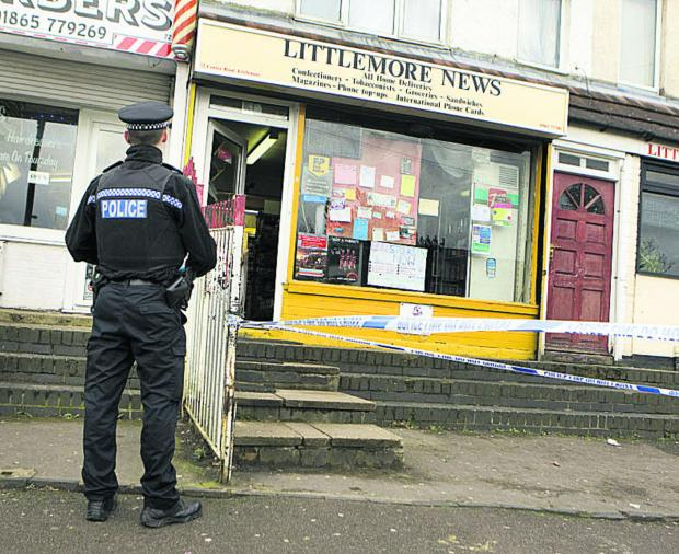 thisisoxfordshire: A police officer outside Littlemore News yesterday