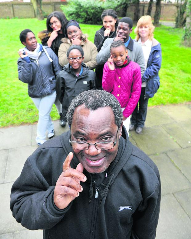 thisisoxfordshire: Father Nazariuz Mgungwe with some of the young people taking part in the Christian Youth Quiz Picture: OX65526 Denis Kennedy