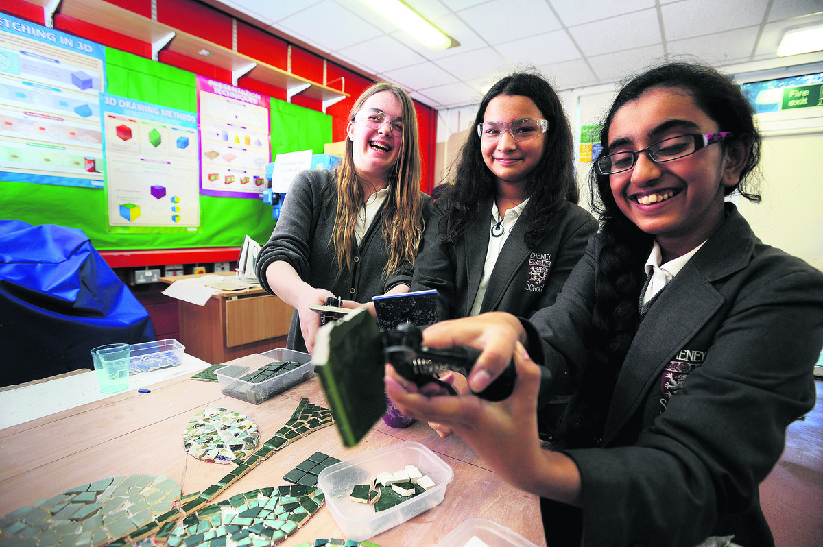 From left, Beth Aveyard, 13, Lana Pagnier, 12, and Brighty Varughesekakkunnathu, 12, work on the mosaic for