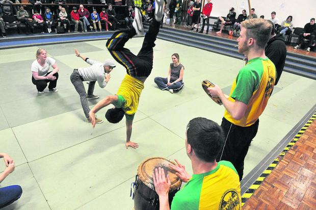 thisisoxfordshire: ACROBATIC: Oxford Capoaira Team perform in aid of Paul Coleman, below