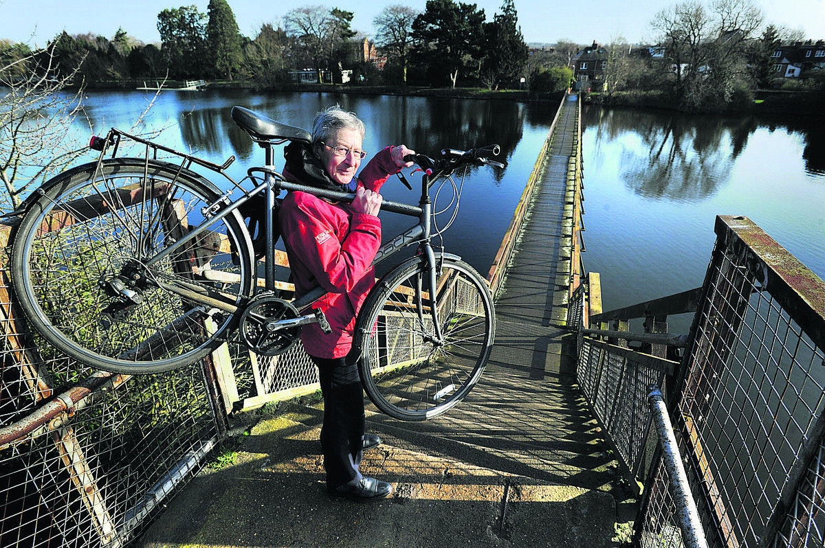 City council leader Bob Price negotiates the footbridge with his bike