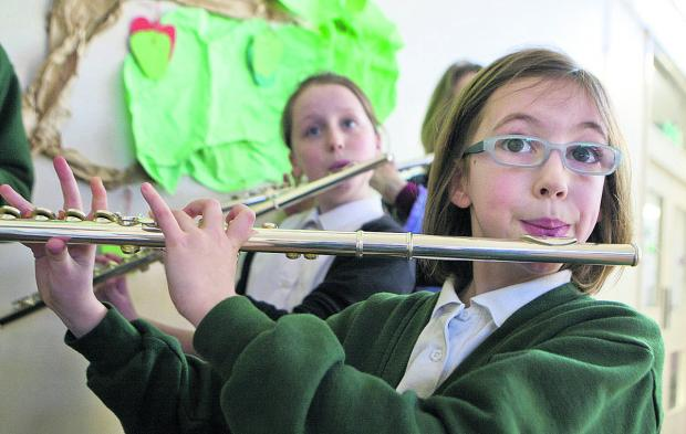 thisisoxfordshire: Megan Rees, 10, plays the flute in the new wind band at St Swithin's School, Kennington    Picture: OX65597 Antony Moore