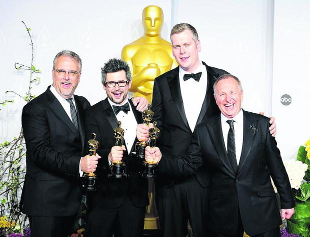 thisisoxfordshire: From left, Skip Lievsay, Niv Adiri, Christopher Benstead and Chris Munro with their Sound Mixing Academy Awards for Gravity