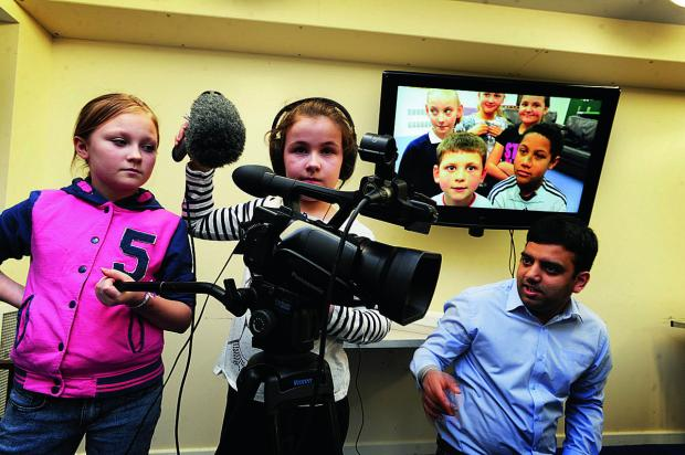 On the camera and sound here, from left, are Kirsty Gifford, 10, and Lily Matthews-White, eight, with video supervisor Anil Subhrai from Film Oxford      Picture: OX65601 Jon Lewis