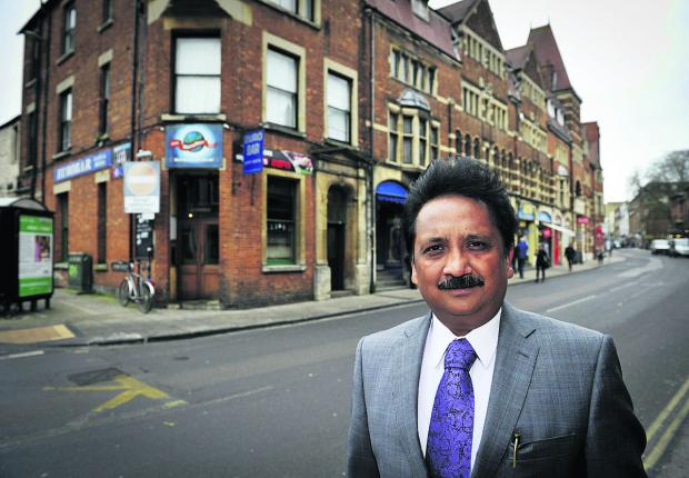thisisoxfordshire: Dr Padmesh Gupta outside the Eurobar in George Street   Picture: OX65775 Mark Hemsworth
