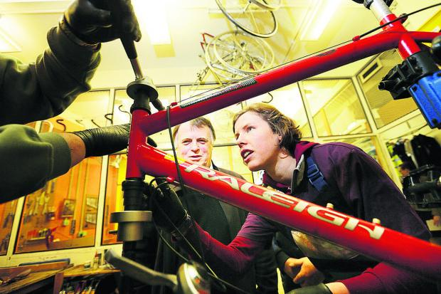 thisisoxfordshire: Andrew Smith MP watches Elle Smith install a bicycle headset Picture: OX65495 Damian Halliwell