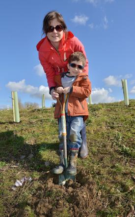 Helping to dig and plant trees at Fry's Hill Park in Blackbird Leys, are Alex Bolam, five and his mum, Emma