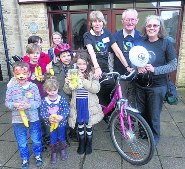Wendy Maddison, sitting on the bike, with visitors to the event at the High Street Methodist Church