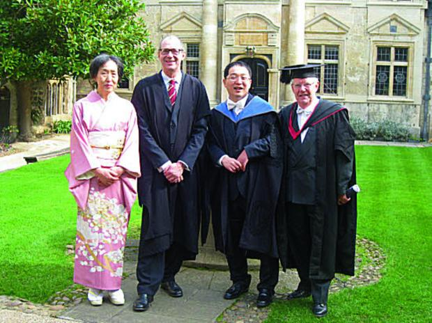 thisisoxfordshire: MILESTONE DAY: Kentaro Ikeda and mum Reiko in the gardens of St Edmund Hall, with the Principal, Professor Keith Gull, and the Senior Dean Professor David Phillips