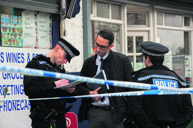 thisisoxfordshire: Police at the scene of the crime at Stan James bookies   Picture: Greg Blatchford