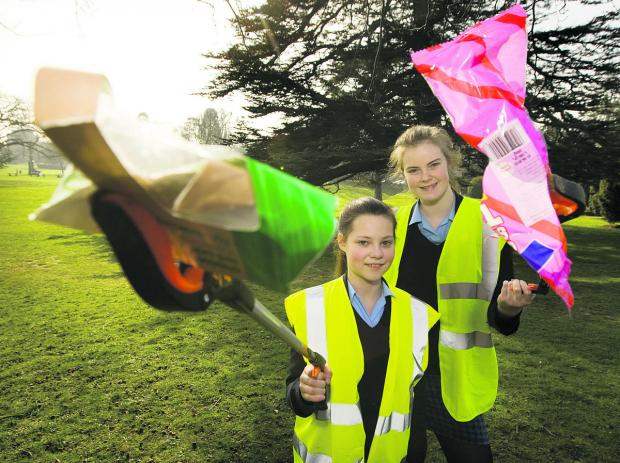 thisisoxfordshire: Year 9 Headington School girls Emma Windle and Olivia Henderson, both 13, go litter picking; inset, Emilie Walker, 13 Picture: OX65886 Antony Moore