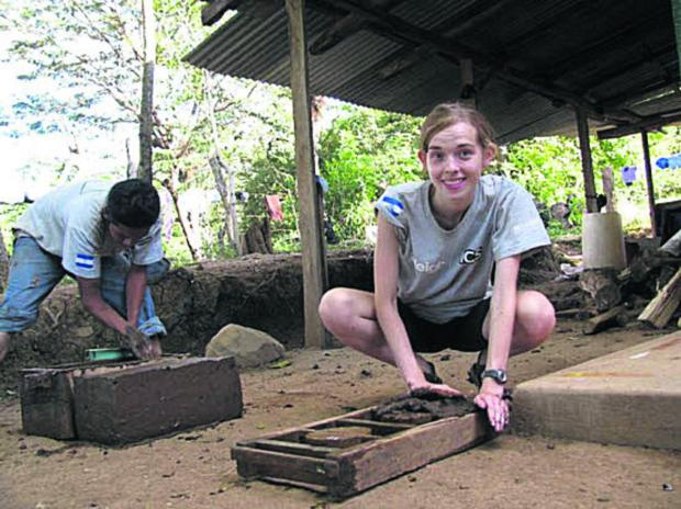 thisisoxfordshire: Emma Pearce making mud bricks