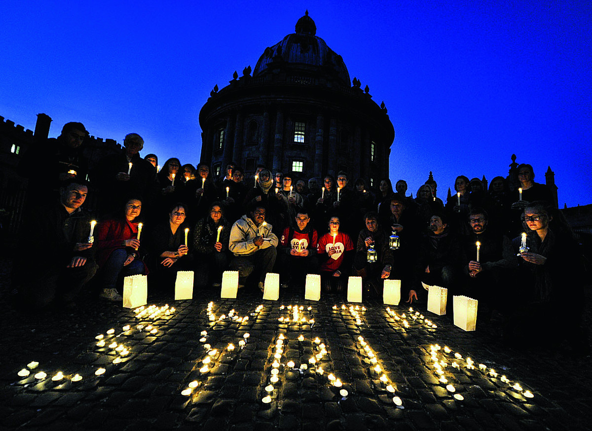 Oxfam arranged a candlelit vigil outside the Radcliffe Camera in Oxford city centre, as part of a global day of action highlighting the third anniversary of the start of the Syria crisis