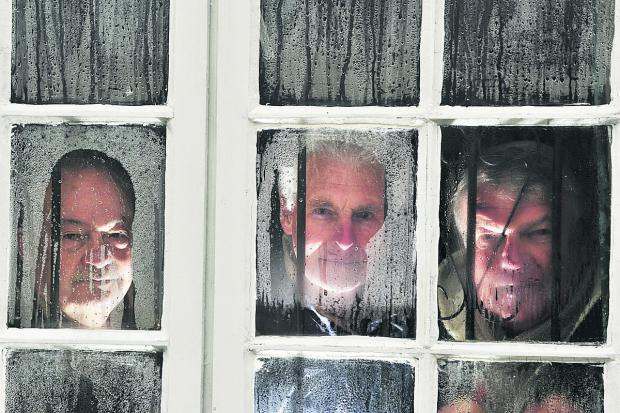 From left, West Oxford Bowls Club committee member Mick Pinfold, member Cyril Honour and president Mick Alderson peer out through the bar windows