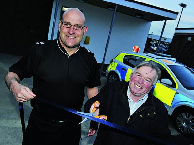 thisisoxfordshire: Sgt Colin Travi of Kidlington Police and Cllr Maurice Billington cut the ribbon for the opening of the new front counter at Thames Valley Police headquarters