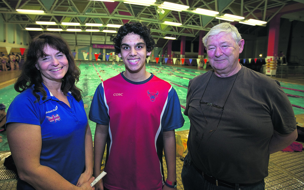 MOTIVATED: Nat Armstrong with City of Oxford Swimming Club head coach Amanda Booth and his grandfather Bob Armstrong