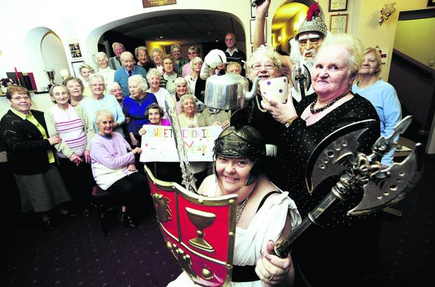 Sweet Memories members including Molly Stimpson, front, as a gladiator, and Christine Burden, right, are all putting in an extra 50p a week to keep the club going