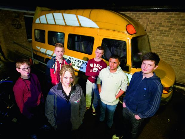 thisisoxfordshire: Wolvercote Young People's Club fundraising manager Amanda Chapple with, from left, club members Harry Goodall, 13; Hayden Bunce, 16; Ben Strong, 15; Kane Jackson, 16 and Ellis Forbes, 15, and the minibus they currently use