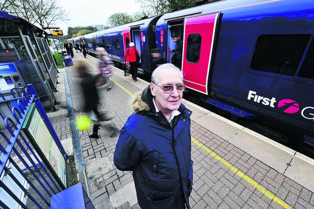 Andrew Wilkins, of the Cotswold Line Promotion Group, at Hanborough station as passengers get off an afternoon peak train from Oxford