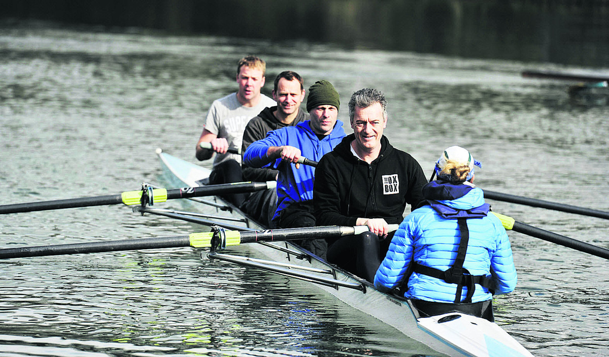 From left, coach Allan French explains the art of rowing to three of the fire