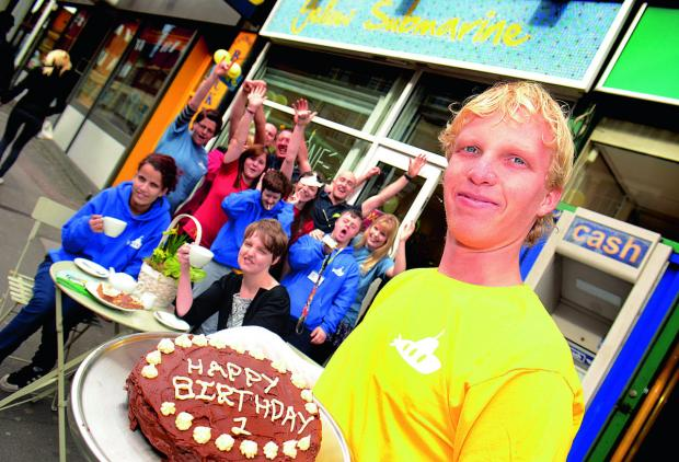 Worker Anthony Langdon celebrates Yellow Submarine cafe's first birthday with colleagues at the Park End Street business. Picture: OX66046 Marc West