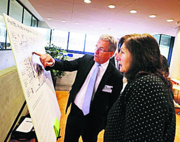 Mike Wigg, director of capital projects and property management for Oxford University, speaks to resident Sue Greenwood at the public consultation. Picture: OX66087 Damian Halliwell