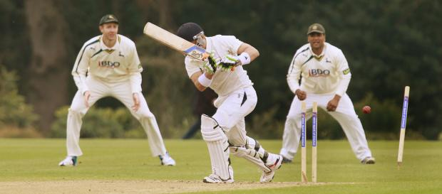 Oxford MCCU's Nick Ferraby loses his off stump to Steven Mullaney