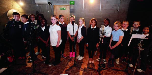 Wood Farm Primary School pupils recording their song We Stand Tall
