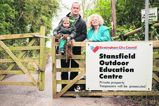 thisisoxfordshire: Left to right: Finley Spooner, Andy Spooner, deputy head at Windmill Primary School in Headington, and Cllr Roz Smith at the centre