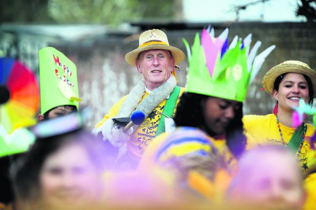 thisisoxfordshire: Retiring headteacher Mark Chesterton joins the Easter parade at Larkrise Primary School             Picture: OX66332 Damian Halliwell