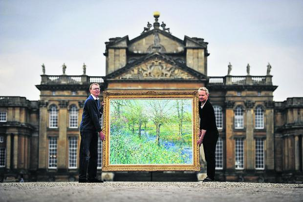 thisisoxfordshire: David Glaisyer, left, and son Caradoc with a Charles Neal painting at the palace              Picture: OX66336 Mark Hemsworth