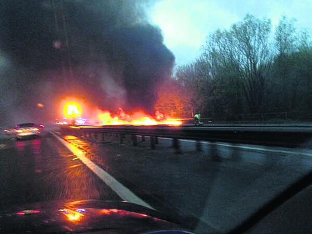 Motorway closed after coach catches fire