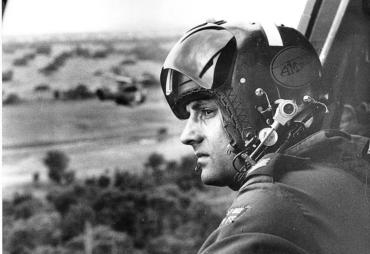 Brian Jopling looks out of a Puma helicopter over Rhodesia during the transition to black majority rule in 1980