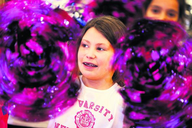 Amelie Herbert, 11, with pom-poms. Picture: OX66455 Damian Halliwell