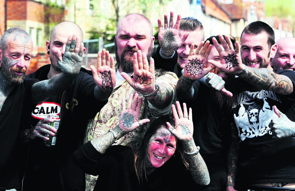 Tattooist Curly Moore, far left, decided to give away free palm tattoos yesterday