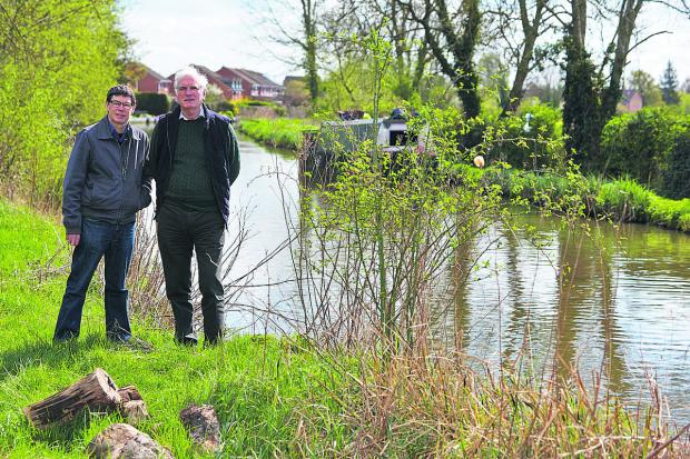 thisisoxfordshire: Kidlington parish and Cherwell district councillor Tim Emptage, left, with Kidlington Parish Council vice-chairman David Robey by the canal