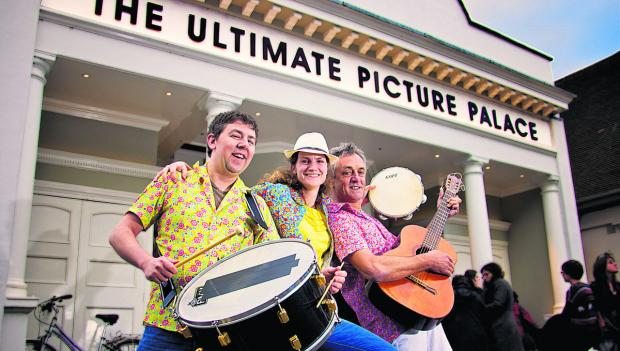 Three members of the Illustrious Sambistas outside the Ultimate Picture Palace at last year's carnival, from left, Phil Pritchett, Bethan Emmet and Peter Williams. Inset right: Carn