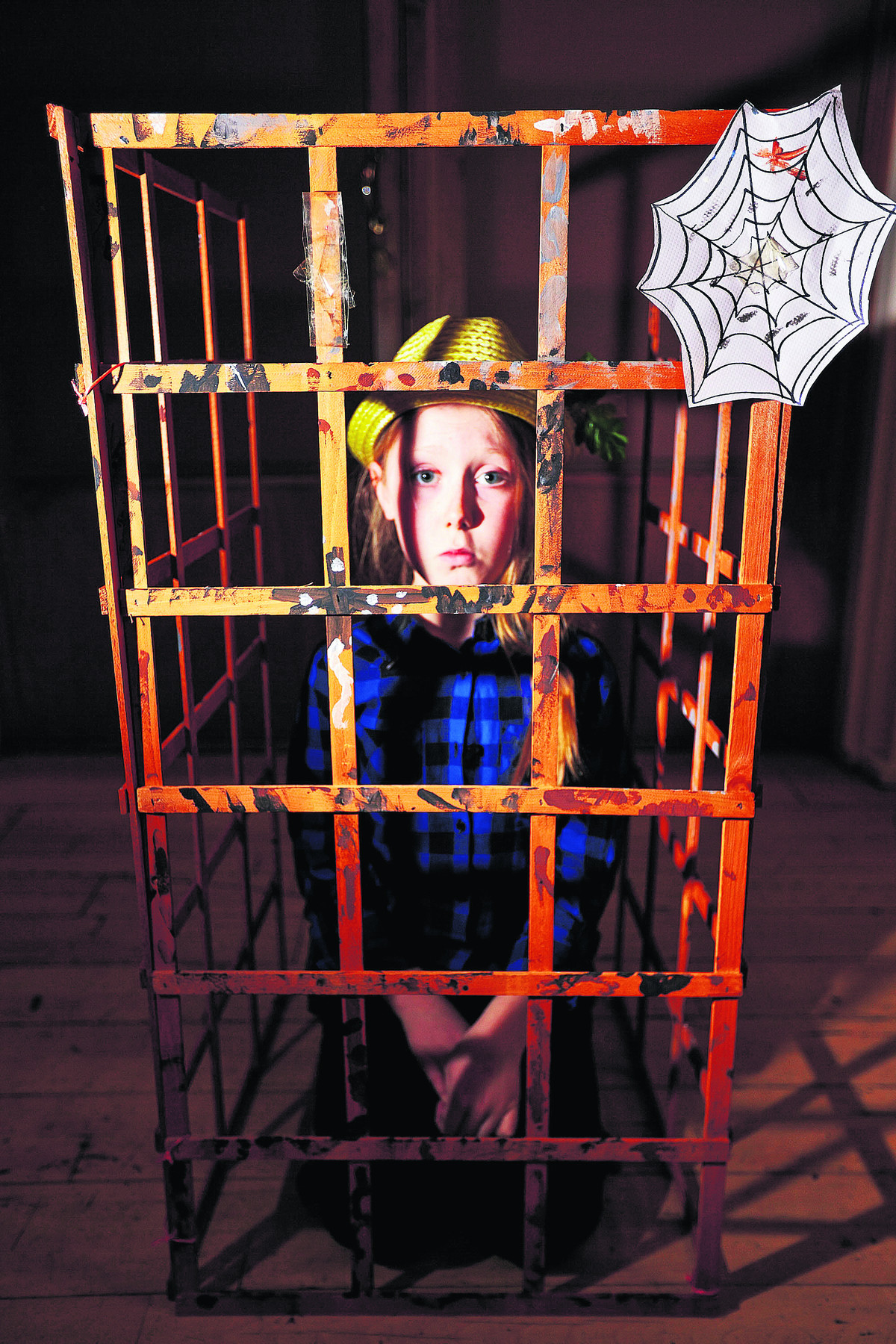 Erin Ewen, playing Hansel, is pictured in a cage made by the cast