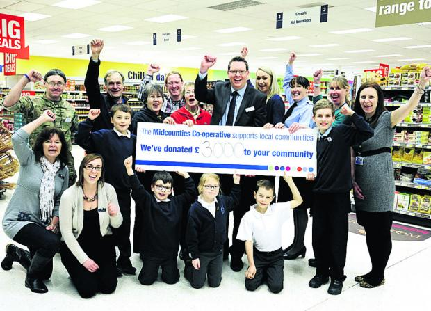 thisisoxfordshire: Store manager Chris Chandler, back, centre, with representatives of the groups and schools which have benefited from donations from Carterton Co-op