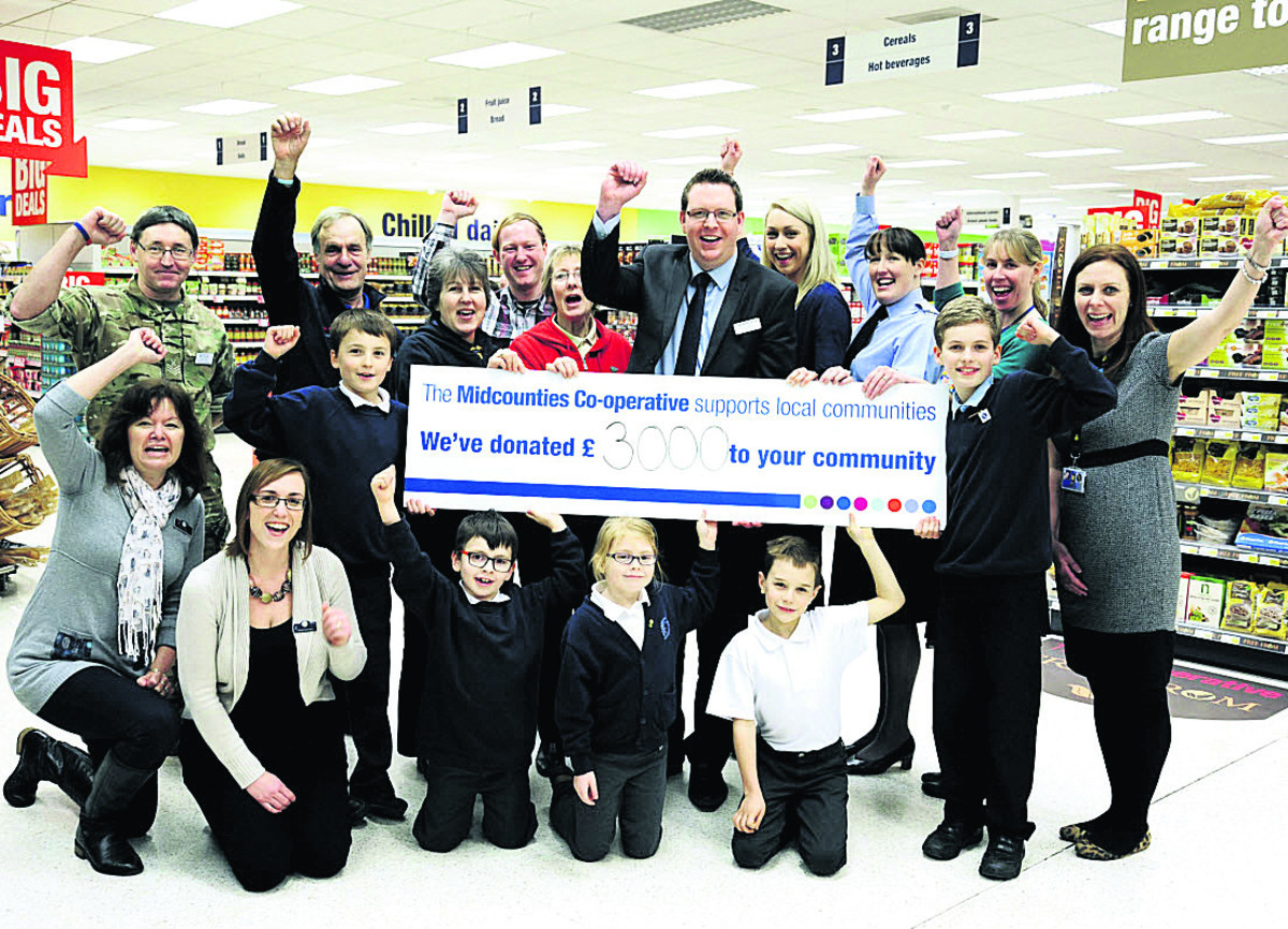 Store manager Chris Chandler, back, centre, with representatives of the groups and schools which have benefited from donations from Carterton Co-op