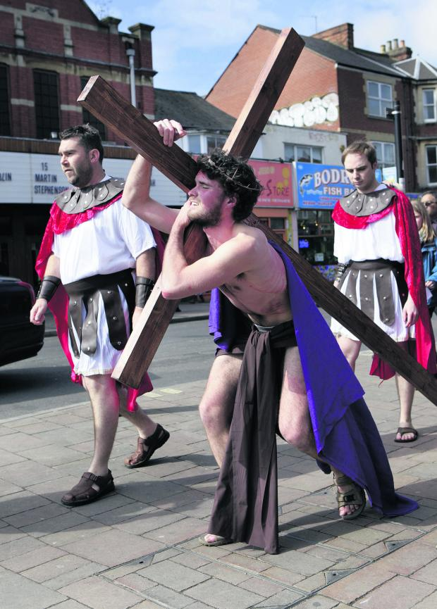 thisisoxfordshire: Mischa Richards plays Jesus in the play held on Cowley Road in 2012