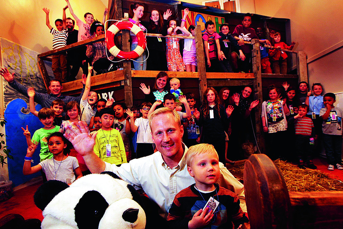 Pastor Derrick Morlan at the ark with his son Micah Morlan, four, and children from the chapel's Bible Club. Picture: OX66620 Ed Nix