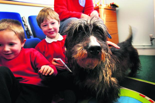 Major on a visit to  St Nicholas' Primary School in March last year. He is pictured with Josh Holton, left, and Oscar Pocock