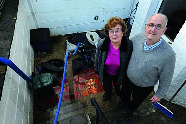 thisisoxfordshire: Oxford residents Michael and Maura Dennehy in their flooded Western Road basement when the storms hit
