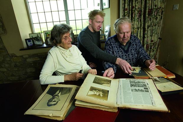 thisisoxfordshire: am and husband John Gee look through the Thomas 'Jack' Rogers scrapbook with grandson Jack