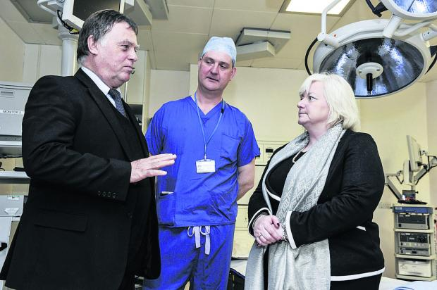 Andrew Smith MP, left, discusses the plan for a specialist £4m gamma knife surgery centre with consultant neuro surgeon Dick Stacey and Manor Hospital director Lynne Brooks    Picture: OX66424  Mark Hemsworth