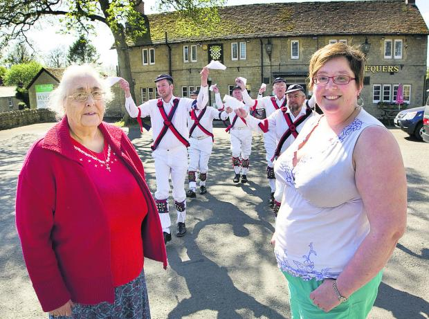 thisisoxfordshire: Julie Kimber-Nickelson, left, and Cat Kelly with members of Headington Morris
